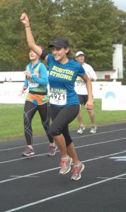 Crossing the finish line of my first half marathon without headphones!