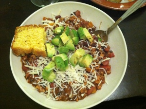 Topped with cheese and avo, and accompanied by cornbread, because YUM.